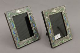 A pair of Art Nouveau style silver photograph frames. 19 cm high.