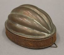 A Victorian tinned copper mould. 14.5 cm long.
