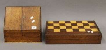 A Victorian inlaid games board/box and a Victorian oak stationery box.