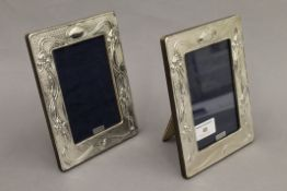 A pair of silver photograph frames. 18.5 cm high.