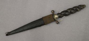 An antique horn handled dagger. 26 cm long.