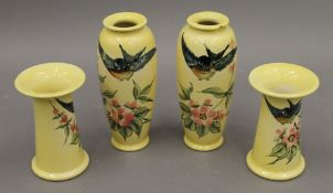 Four Christopher Dresser Ault vases. The largest 16 cm high.