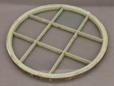 A vintage glazed circular window panel. 80 cm diameter.