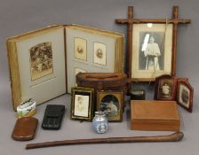 A box of various items, including photograph album, swagger stick, etc.