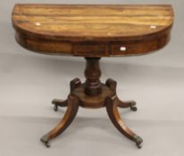 A Regency inlaid rosewood demi lune card table. 90.5 cm wide.