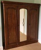 A Victorian mahogany three door wardrobe. 188 cm wide, 205 cm high, 55.5 cm deep.