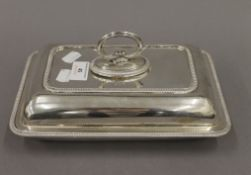 A silver entree dish. 26 cm long. 31.4 troy ounces.