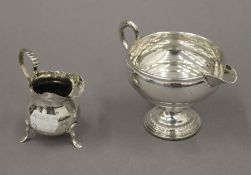 Two silver cream jugs. The largest 8 cm high. 3.9 troy ounces total weight.