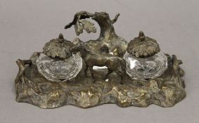 A Victorian silver plated bronze desk stand. 25 cm wide.