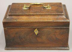 A George III mahogany tea caddy. 24 cm wide.