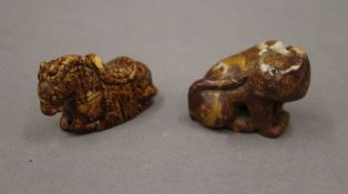 A mottled soapstone carving of a seated cat with inlaid eyes and a Chinese russet jade carving of a