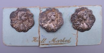 Three Art Nouveau silver buttons. Each 2.5 cm high.