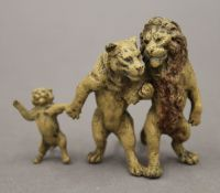 A cold painted bronze model of a lion family. 6.5 cm high.