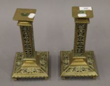A pair of Victorian pierced brass candlesticks. Each 23.5 cm high.