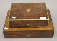 Two brass mounted walnut boxes (converted to cigar boxes). The largest 33.5 cm wide.