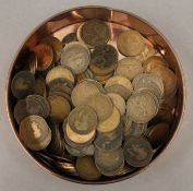 A large collection of British pennies in a farthing tin.