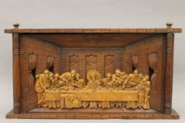A wooden carving depicting The Last Supper. 81.5 cm wide.