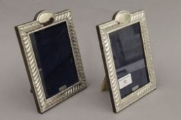 A pair of silver photograph frames. 19 cm high.