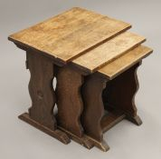 An oak nest of three tables. 50.5 cm wide.