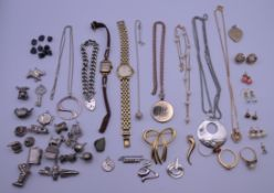 A quantity of miscellaneous jewellery, including silver charms.