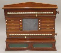 A Victorian/Edwardian mahogany billiards/snooker scoreboard by R Stevens & Sons London. 89 cm wide.
