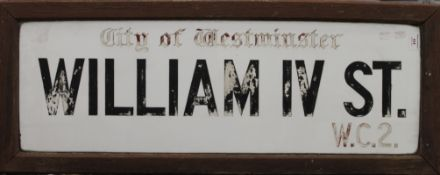A glass City of Westminster William IV ST.W.C.2. street sign, framed. 98 x 38 cm overall.