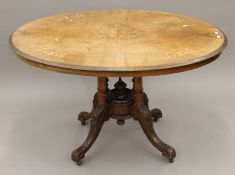 A Victorian walnut loo table. 117 cm long.