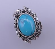 A silver turquoise ring. Ring size S.