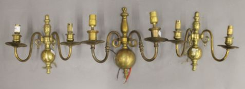 Three brass twin branch wall lights. The largest 27.5 cm high.