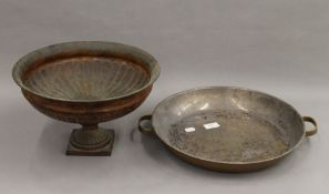 A twin handled copper pan and a toleware tazza. The former 43.5 cm wide.