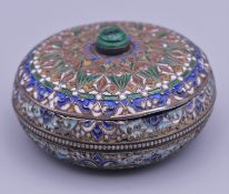 A Russian silver enamel pill box with malachite finial. 5 cm diameter. 60.5 grammes total weight.