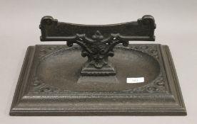 A Victorian cast iron boot scraper. 36 cm wide.