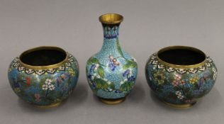 A pair of 19th century Chinese gilt copper cloisonne squat vases and a single gilt copper cloisonne