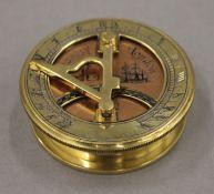 A brass and copper sundial compass. 6.5 cm diameter.