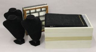 A box of jewellery display trays, various stands and a glass lidded display box.