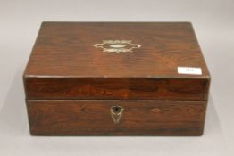 A Victorian rosewood and mother-of-pearl trinket box with inner tray. 30 cm wide.