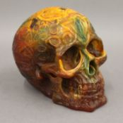 A model of a skull. 13 cm high.