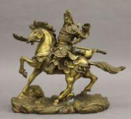 A Japanese bronze model of a warrior on horseback. 25 cm long.