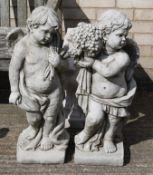 Two cherub garden statues.