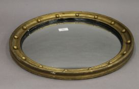 An early 20th century gilt framed convex mirror. 49 cm diameter.