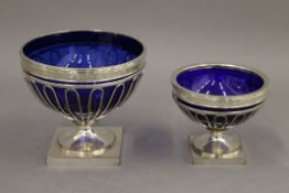Two blue glass lined old Sheffield plate tazzas. The largest 11.5 cm high.