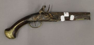 An antique flintlock pistol, the grip with engraved brass mount, possibly of Masonic interest. 37.