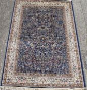 A deep blue ground full pile Kashmir tree of life rug. 240 x 160 cm.