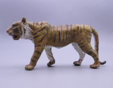 A cold painted bronze model of a tiger. 12 cm long.