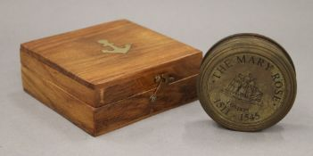 A boxed Mary Rose compass. The box 11 cm wide.