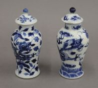 A pair of 19th century Chinese blue and white porcelain vases and covers, decorated with dragons.