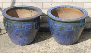 Two blue glazed pottery garden planters.