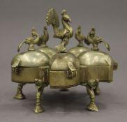 An Indian brass spice box. 9.5 cm high.