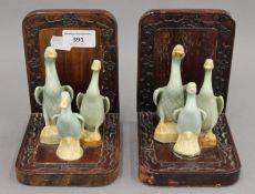 A pair of Chinese bookends, each set with three porcelain ducks. 15 cm high.