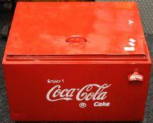 A large Coke cooler box. 56.5 cm wide.